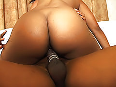 After milking his dick with her tight ebony pussy, he pulls out and cums all over her perfect round black butt